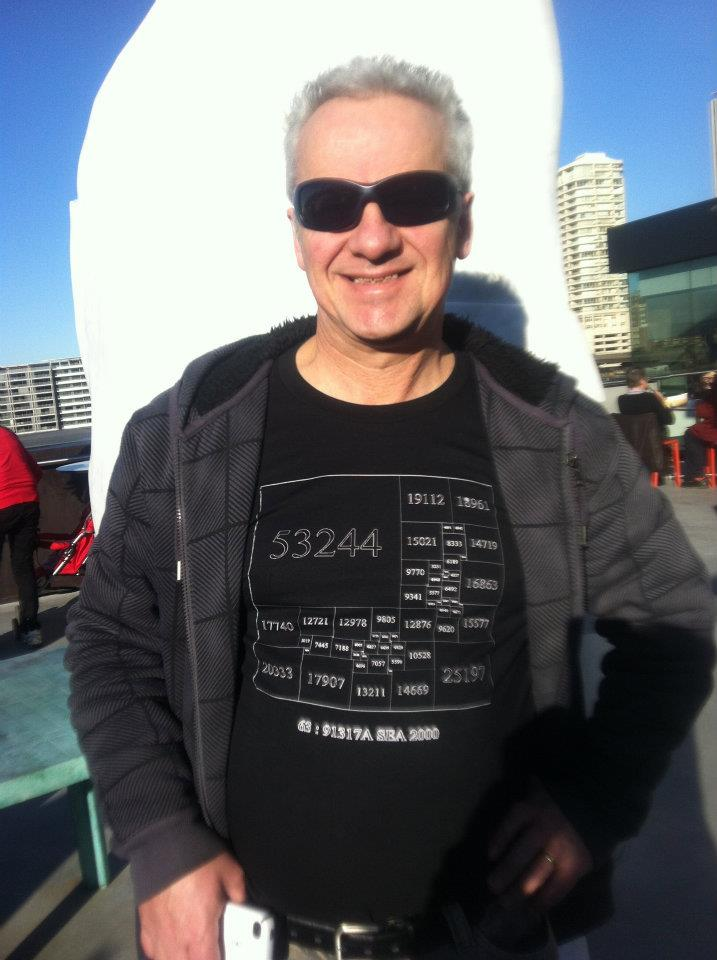 Stuart Anderson, 2012, in a T-shirt displaying his first squared square discovery